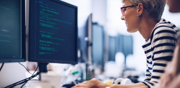 Woman on computer doing data programming